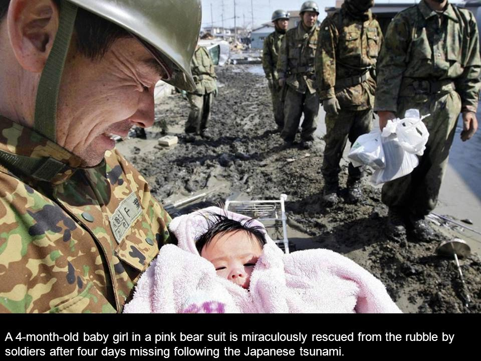 A 4-month-old baby girl in a pink bear suit is miraculously rescued from the rubble by soldiers after four days missing following the Japanese tsunami.