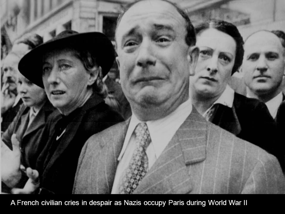 A French civilian cries in despair as Nazis occupy Paris during World War II.