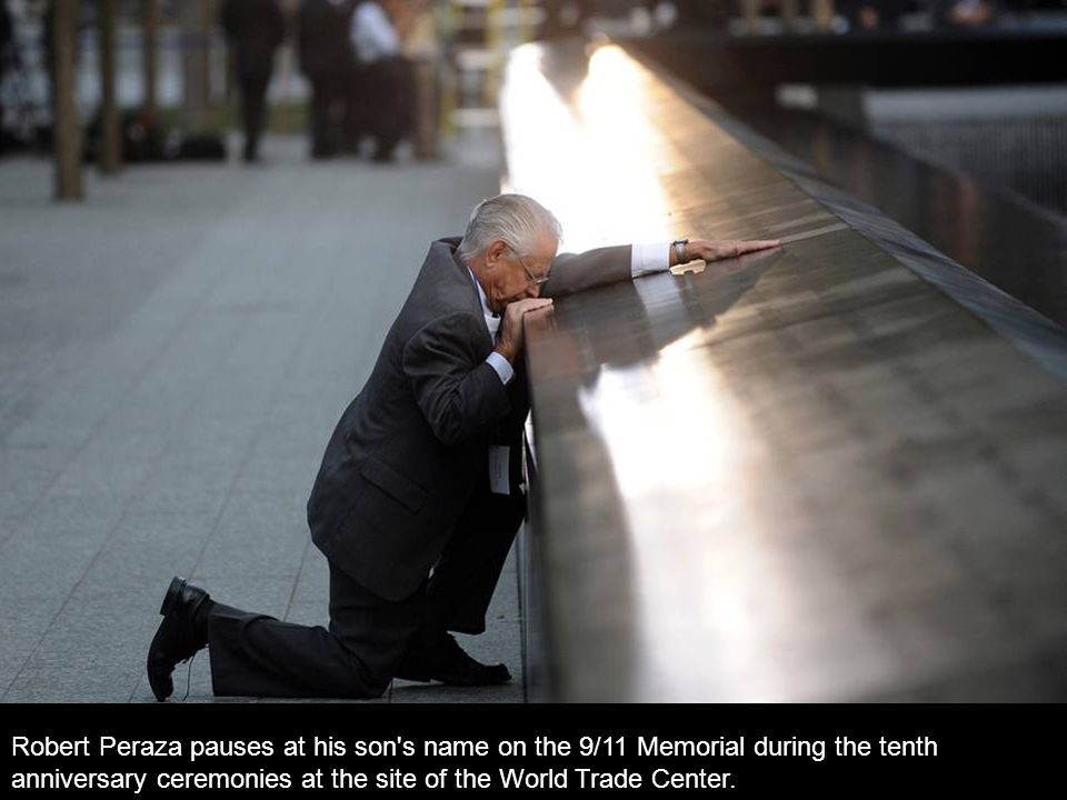 Robert Peraza pauses at his son s name on the 9/11 Memorial during the tenth anniversary ceremonies at the site of the World Trade Center.