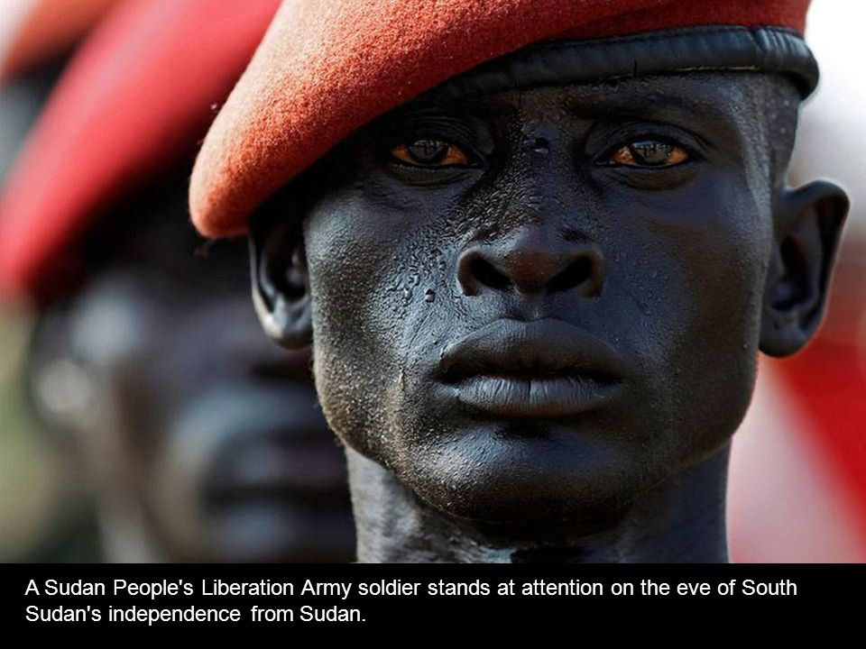 A Sudan People s Liberation Army soldier stands at attention on the eve of South Sudan s independence from Sudan.