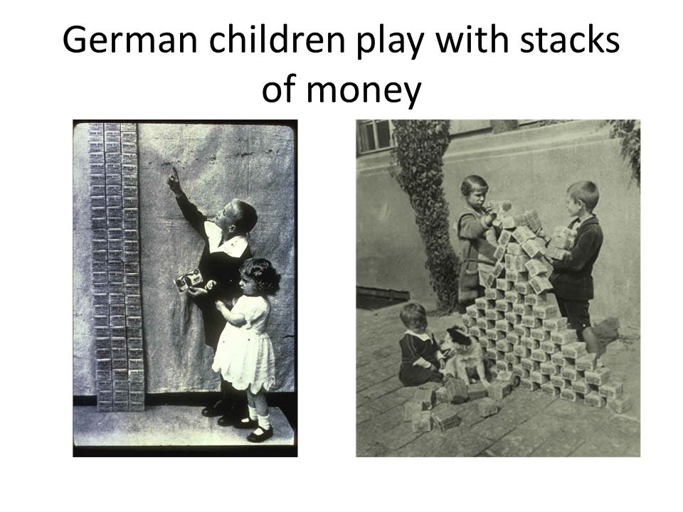 German children play with stacks of money