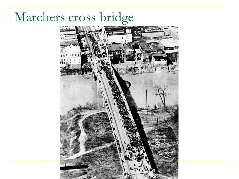 Marchers cross bridge