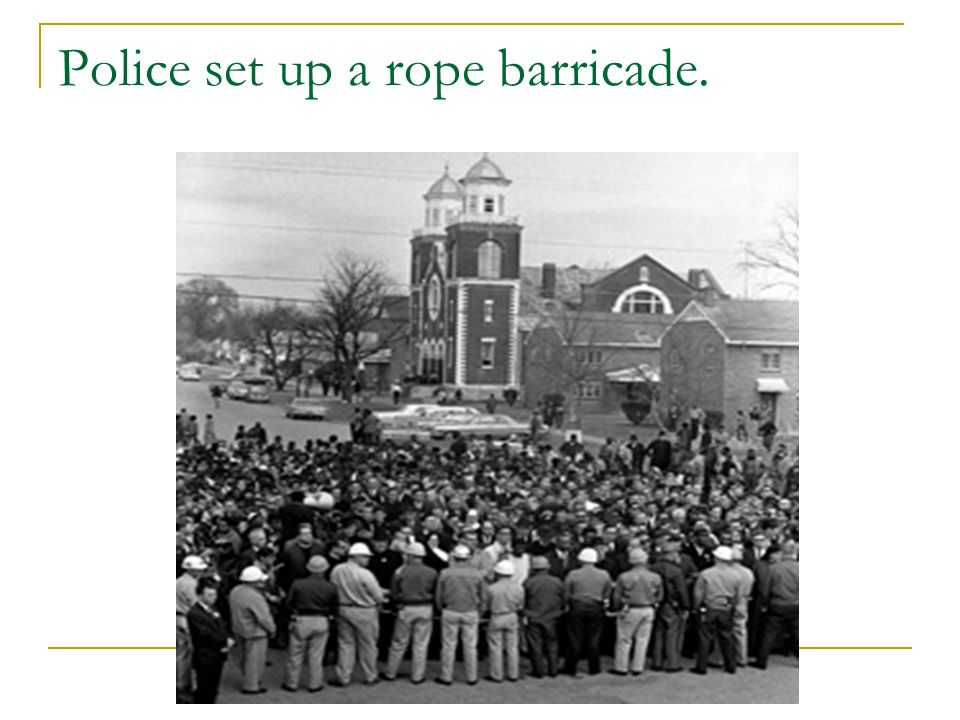 Police set up a rope barricade.