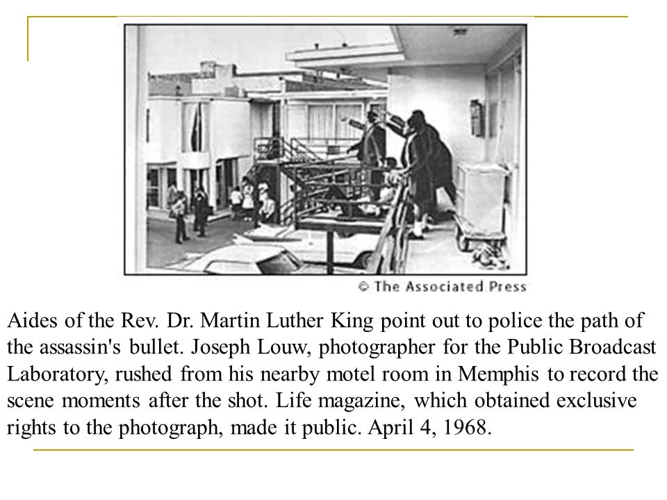 Aides of the Rev. Dr. Martin Luther King point out to police the path of the assassin s bullet.