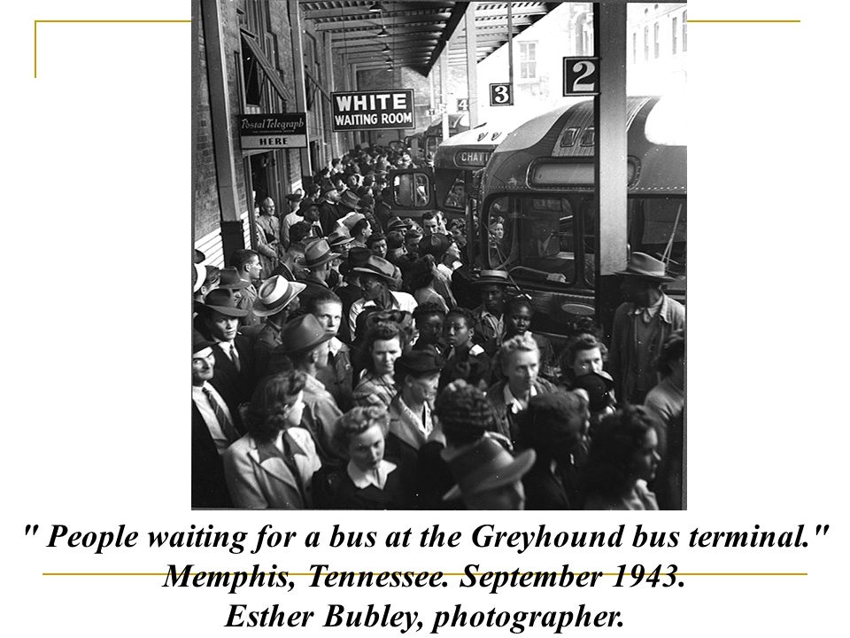 People waiting for a bus at the Greyhound bus terminal