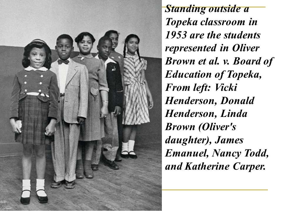 Standing outside a Topeka classroom in 1953 are the students represented in Oliver Brown et al.