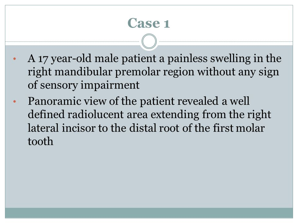 Case 1 A 17 year-old male patient a painless swelling in the right mandibular premolar region without any sign of sensory impairment.