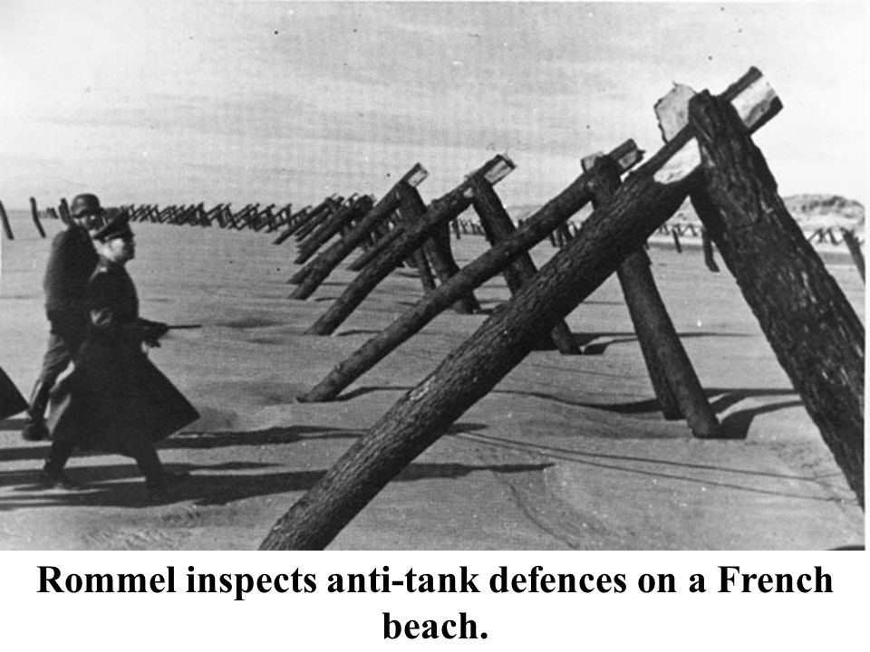 Rommel inspects anti-tank defences on a French beach.