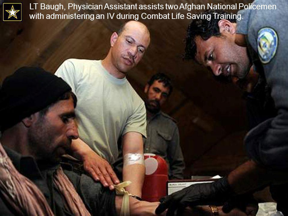 LT Baugh, Physician Assistant assists two Afghan National Policemen