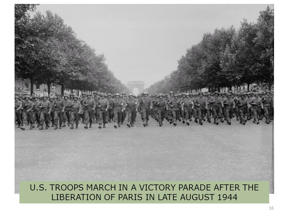 U.S. TROOPS MARCH IN A VICTORY PARADE AFTER THE LIBERATION OF PARIS IN LATE AUGUST 1944