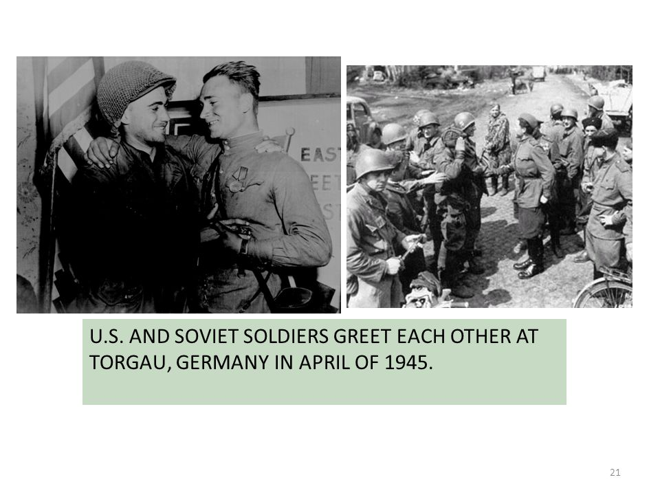 U.S. AND SOVIET SOLDIERS GREET EACH OTHER AT TORGAU, GERMANY IN APRIL OF 1945.