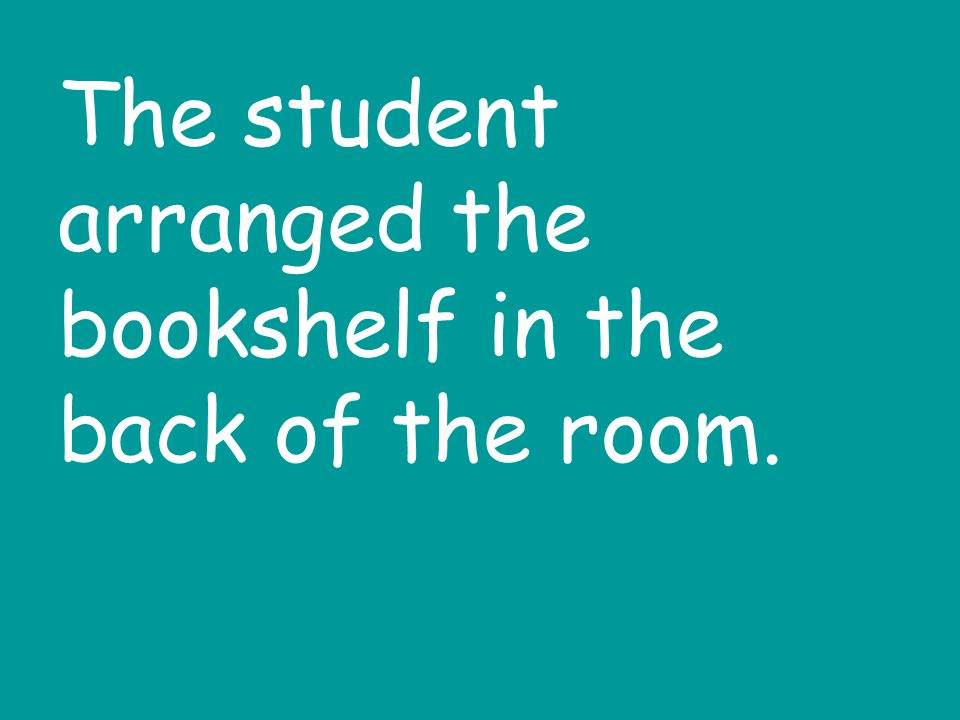 The student arranged the bookshelf in the back of the room.