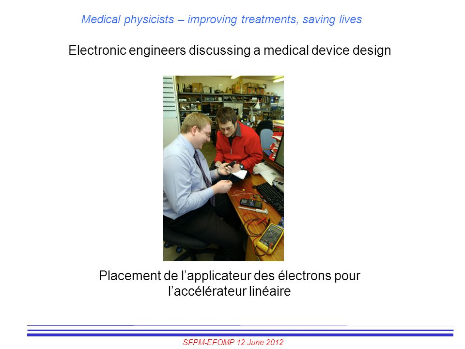 Electronic engineers discussing a medical device design
