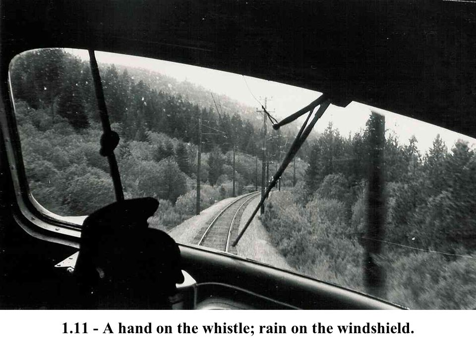 1.11 - A hand on the whistle; rain on the windshield.