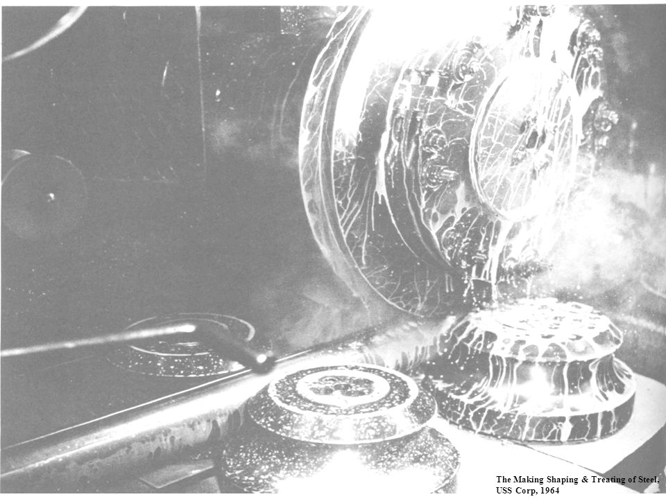 Here is a photograph of the electrode wheels and the final forming and pressure rolls making the weld. Cooling fluid is sprayed over the joint to extract heat.