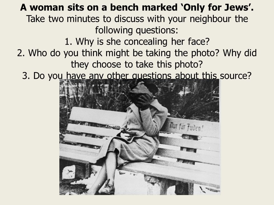 A woman sits on a bench marked 'Only for Jews'