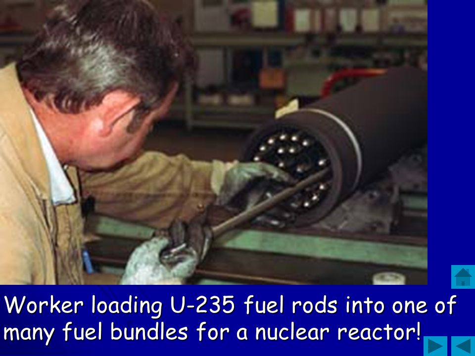 Worker loading U-235 fuel rods into one of many fuel bundles for a nuclear reactor!