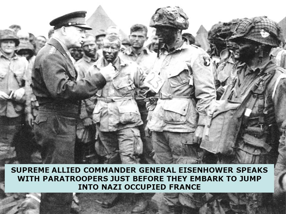 SUPREME ALLIED COMMANDER GENERAL EISENHOWER SPEAKS WITH PARATROOPERS JUST BEFORE THEY EMBARK TO JUMP INTO NAZI OCCUPIED FRANCE