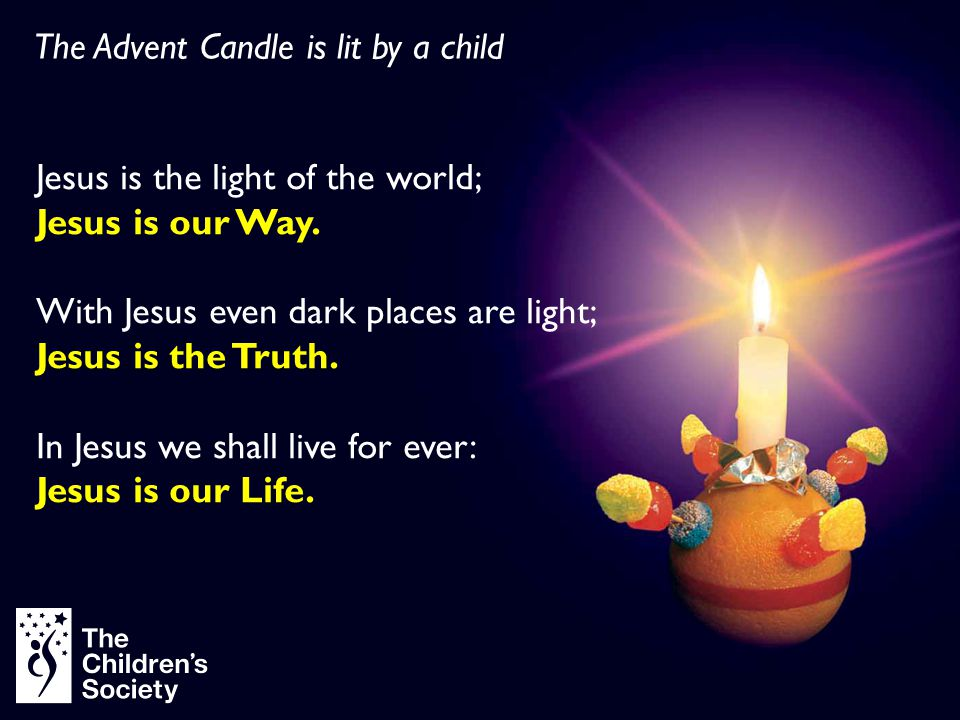 The Advent Candle is lit by a child