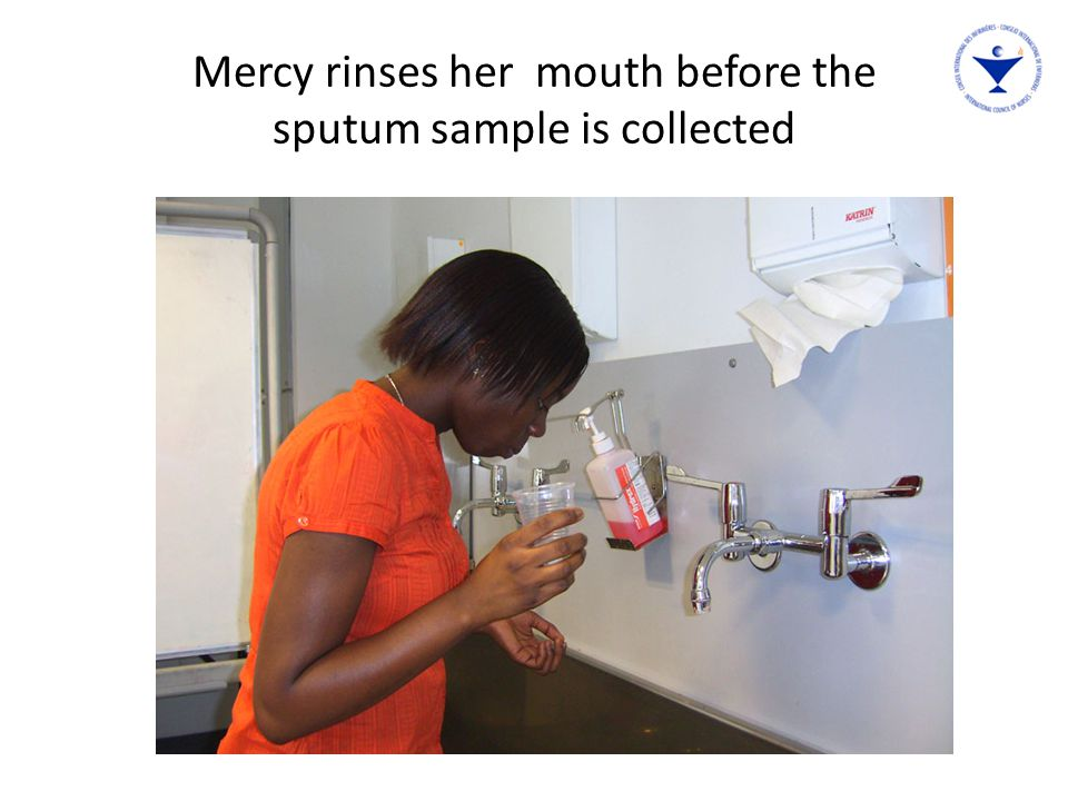 Mercy rinses her mouth before the sputum sample is collected