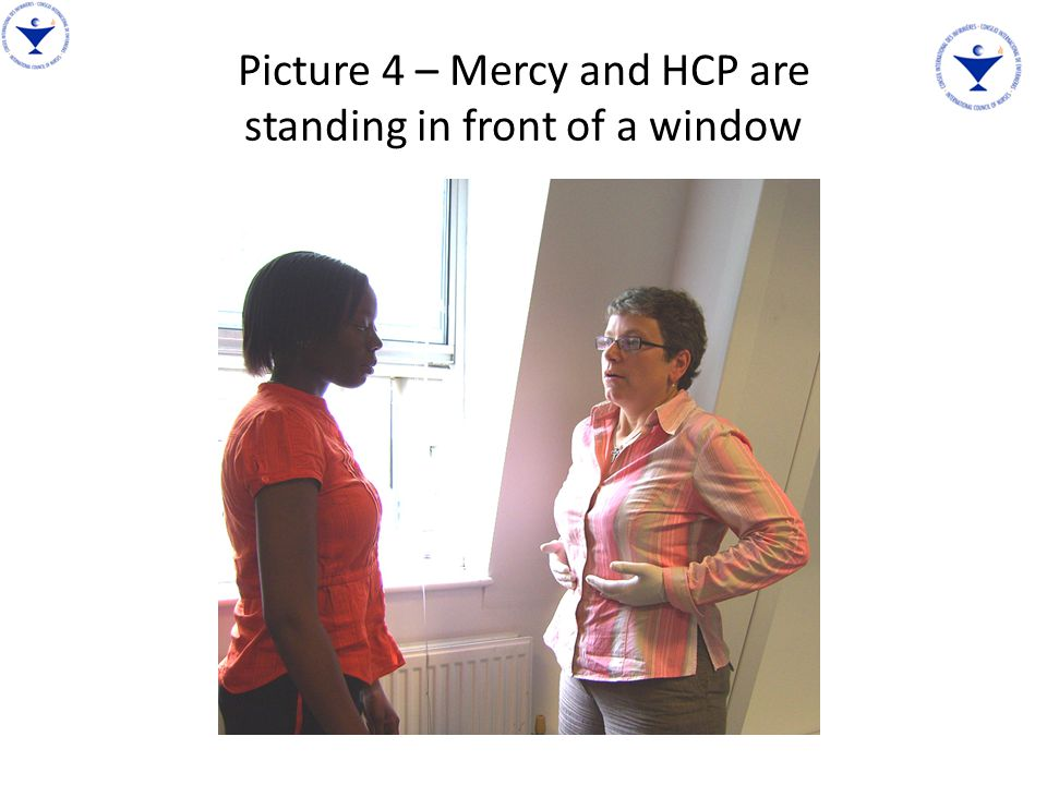 Picture 4 – Mercy and HCP are standing in front of a window