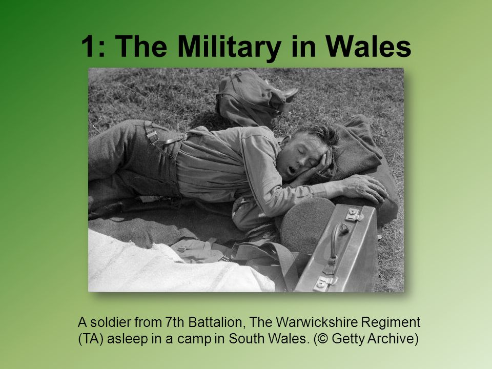 1: The Military in Wales A soldier from 7th Battalion, The Warwickshire Regiment (TA) asleep in a camp in South Wales.