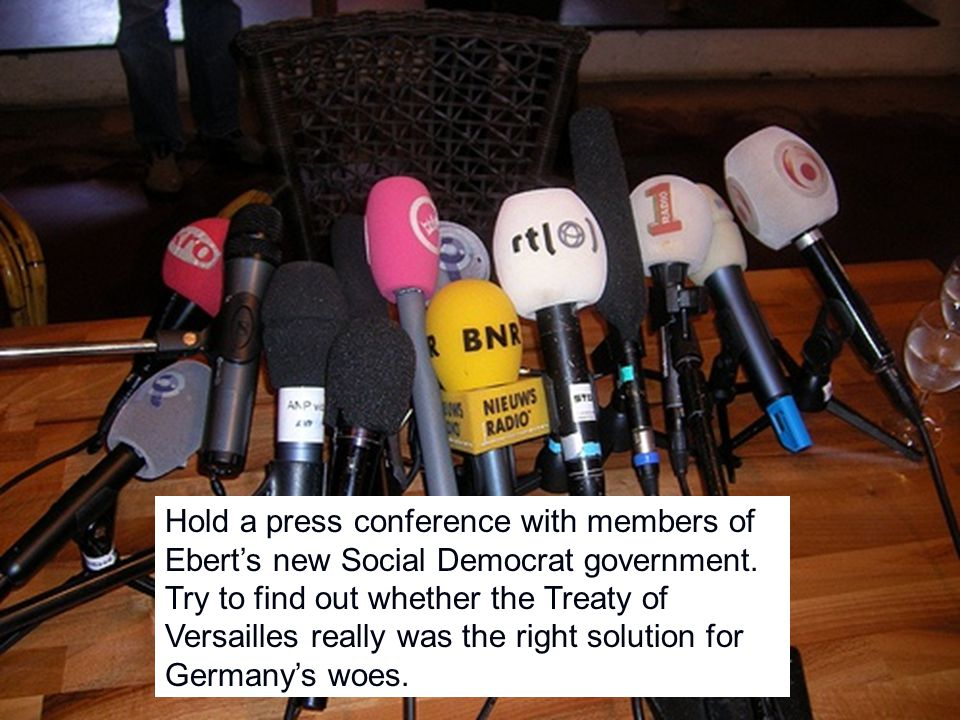 Hold a press conference with members of Ebert's new Social Democrat government.