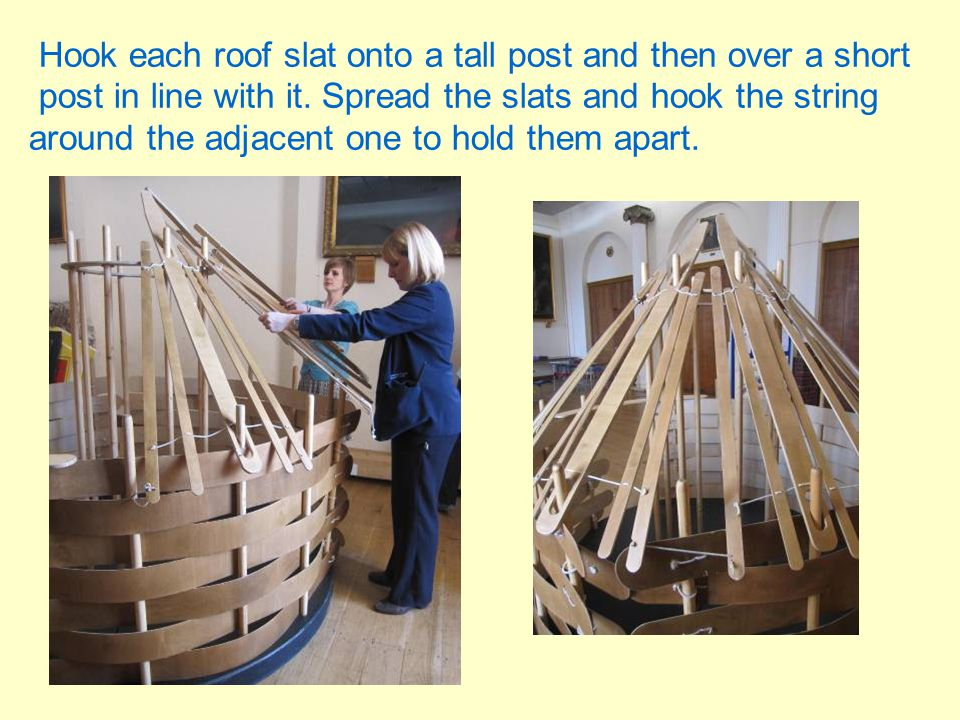 Hook each roof slat onto a tall post and then over a short post in line with it.