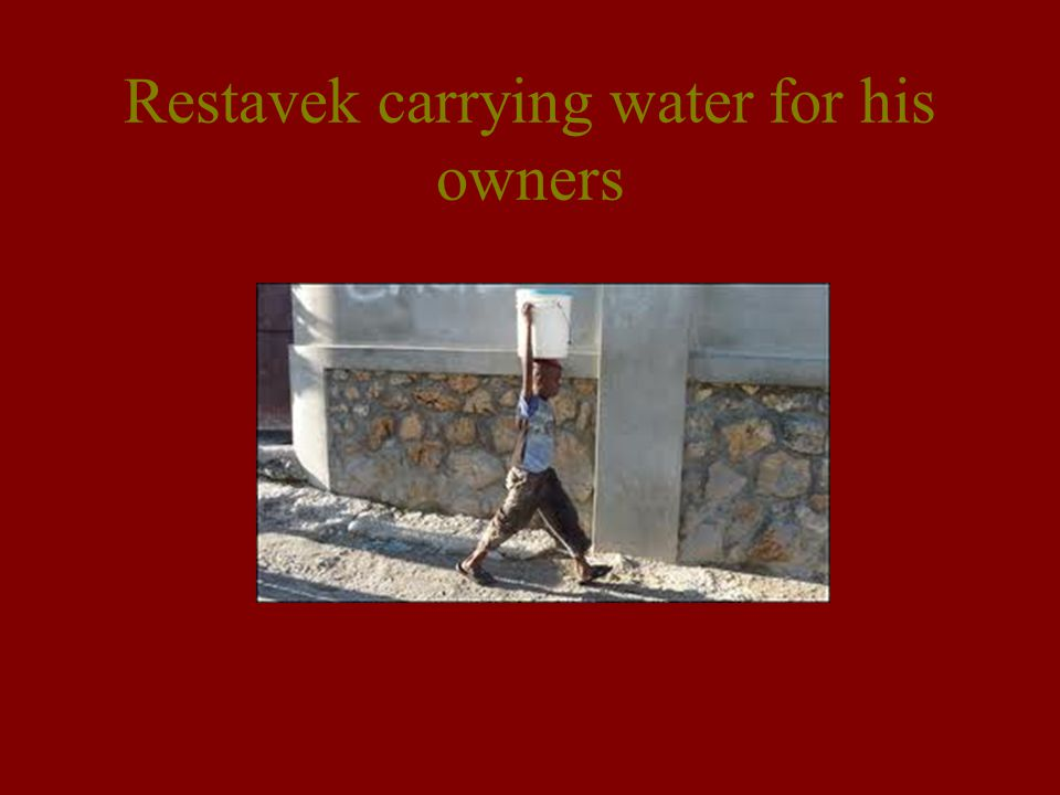 Restavek carrying water for his owners
