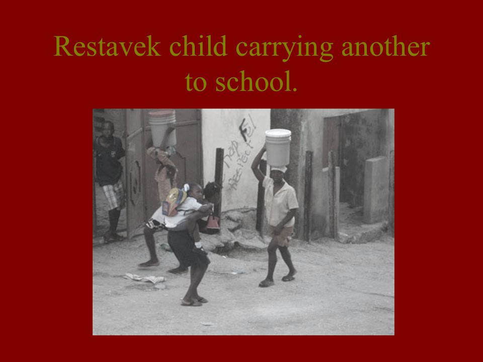 Restavek child carrying another to school.