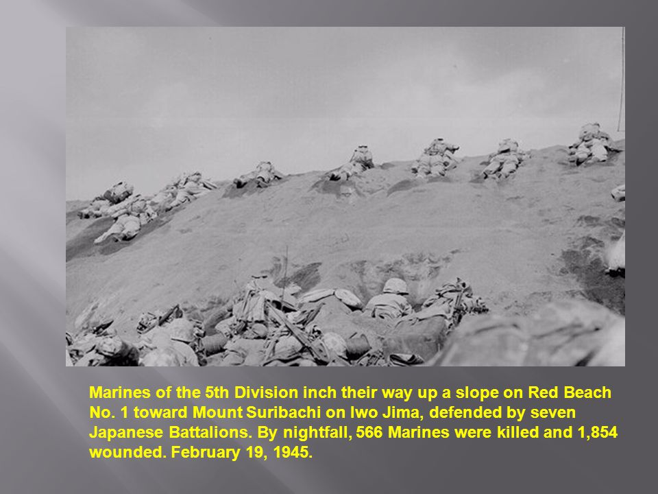 Marines of the 5th Division inch their way up a slope on Red Beach No