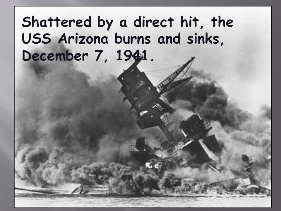 Shattered by a direct hit, the USS Arizona burns and sinks, December 7, 1941.