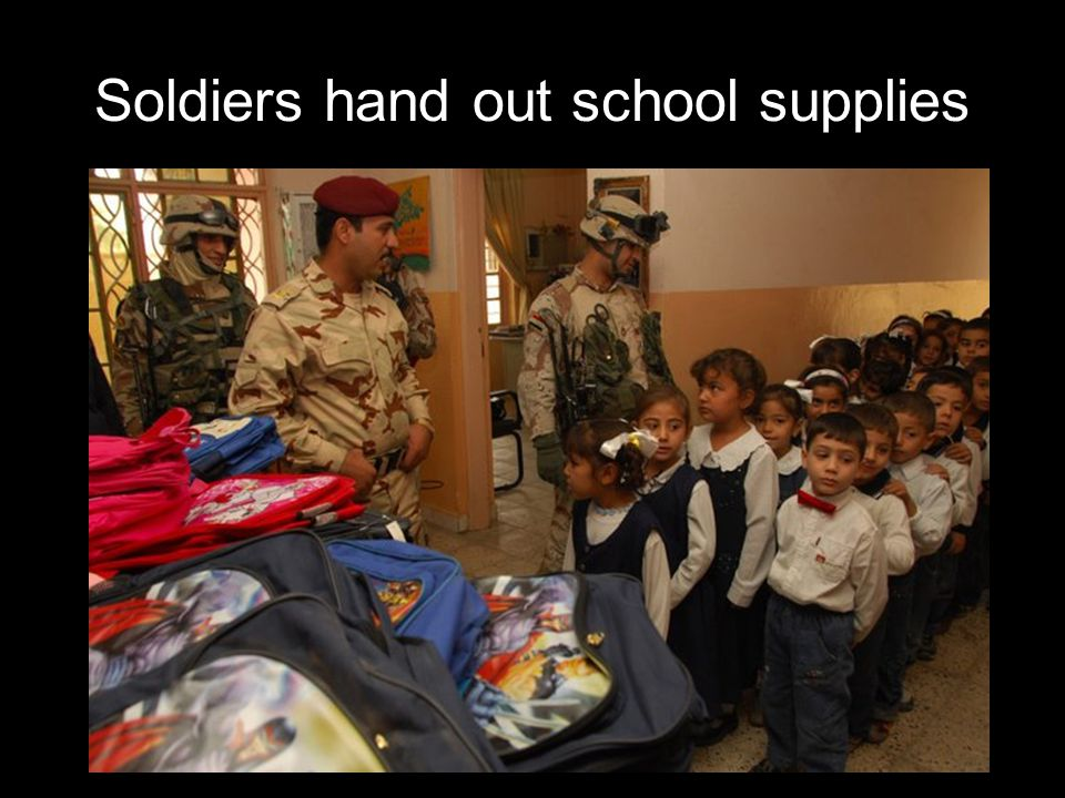 Soldiers hand out school supplies