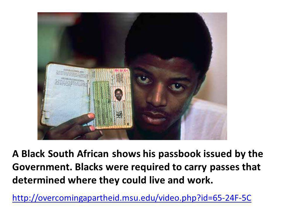 A Black South African shows his passbook issued by the Government