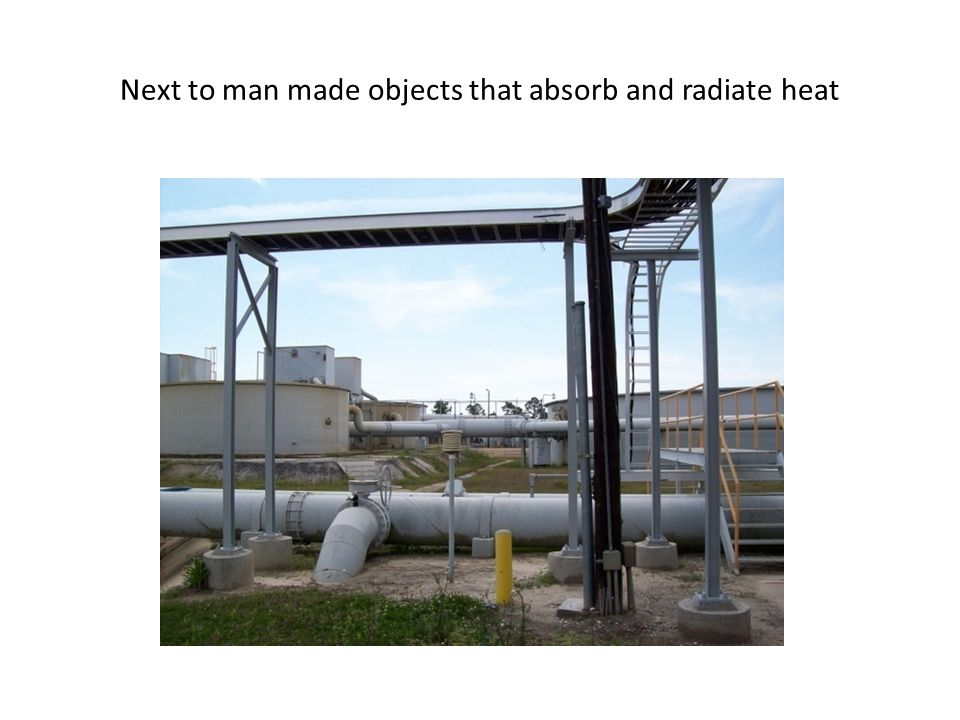 Next to man made objects that absorb and radiate heat