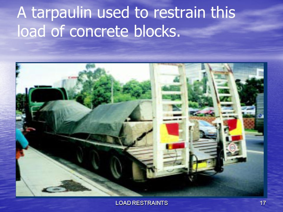 A tarpaulin used to restrain this load of concrete blocks.