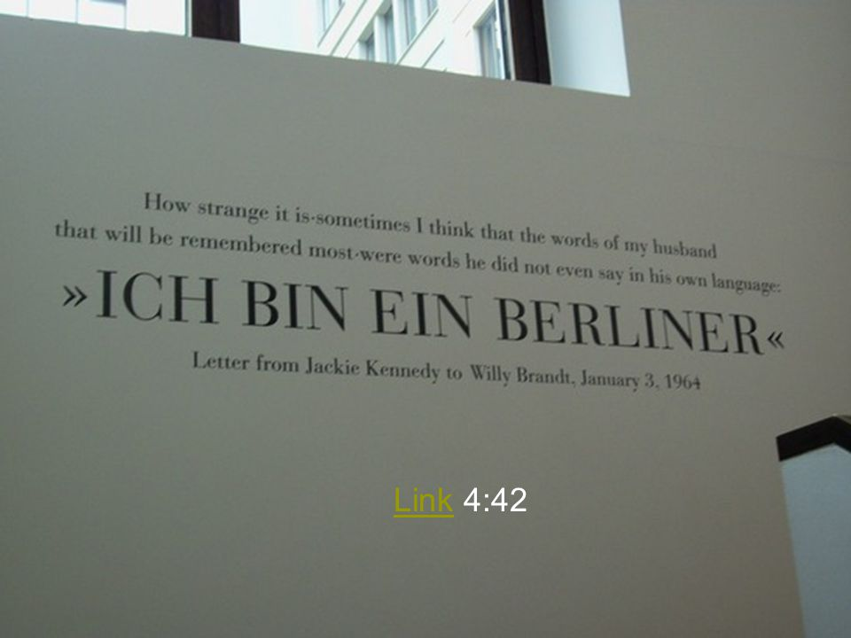 Ich bin ein Berliner ( I am a Berliner ) is a quotation from a June 26, 1963, speech by U.S. President John F. Kennedy in West Berlin. He was underlining the support of the United States for West Germany 22 months after the Soviet-supported East Germany erected the Berlin Wall as a barrier to prevent movement between East and West. The message was aimed as much at the Soviets as it was at Berliners, and was a clear statement of U.S. policy in the wake of the construction of the Berlin Wall. Another notable (and defiant) phrase in the speech was also spoken in German, Lass sie nach Berlin kommen ( Let them come to Berlin )--addressed at those who claimed we can work with the Communists , a remark which Nikita Khrushchev scoffed at only days later.