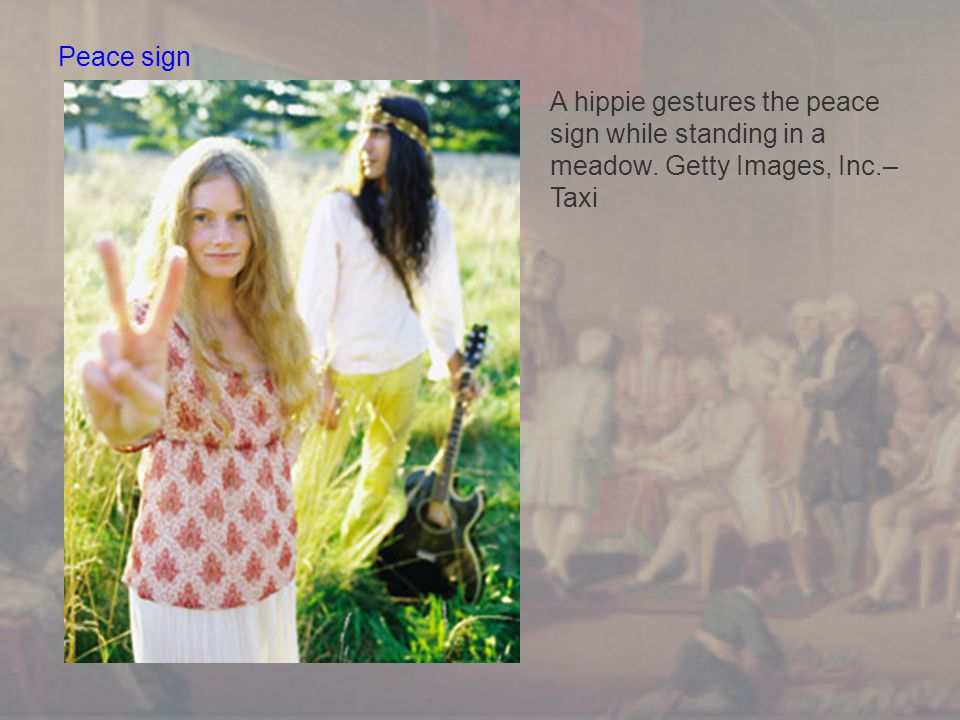 Peace sign A hippie gestures the peace sign while standing in a meadow. Getty Images, Inc.–Taxi