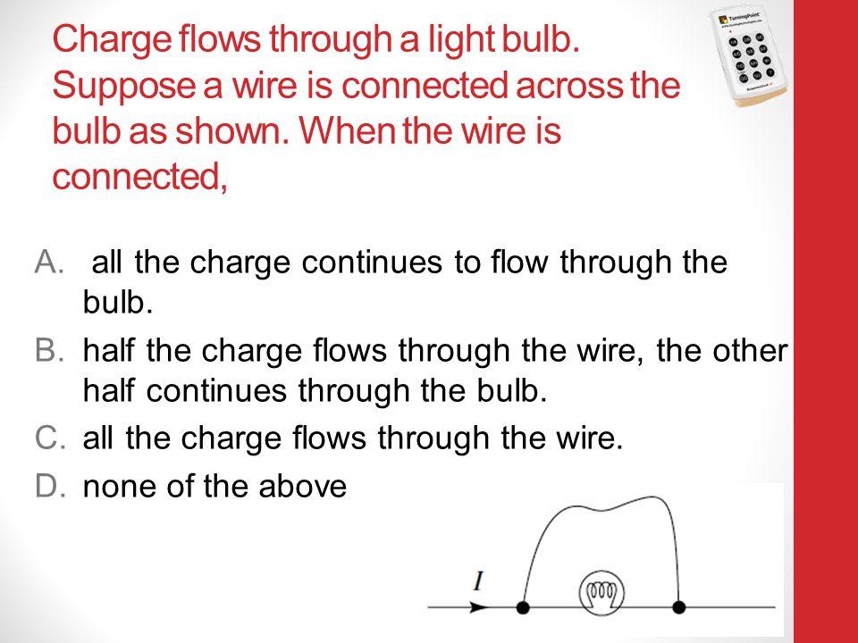 Charge flows through a light bulb