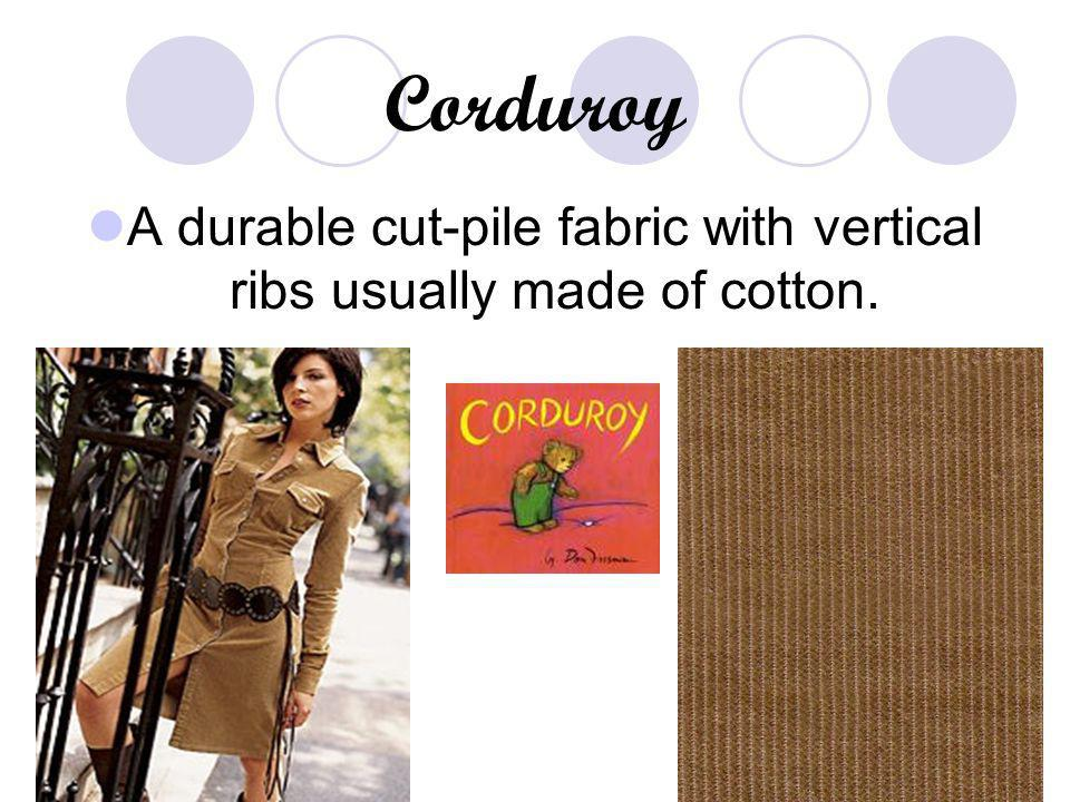 A durable cut-pile fabric with vertical ribs usually made of cotton.