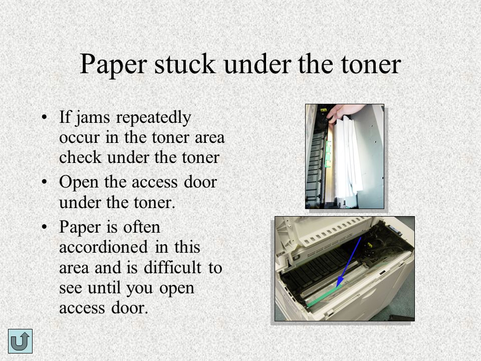 Paper stuck under the toner