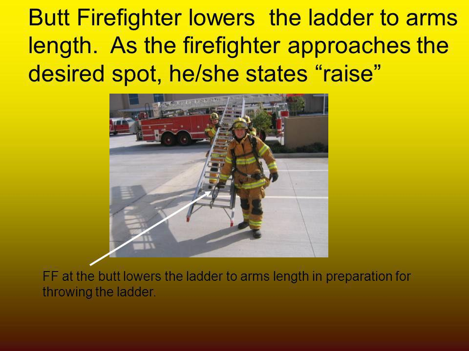 Butt Firefighter lowers the ladder to arms length