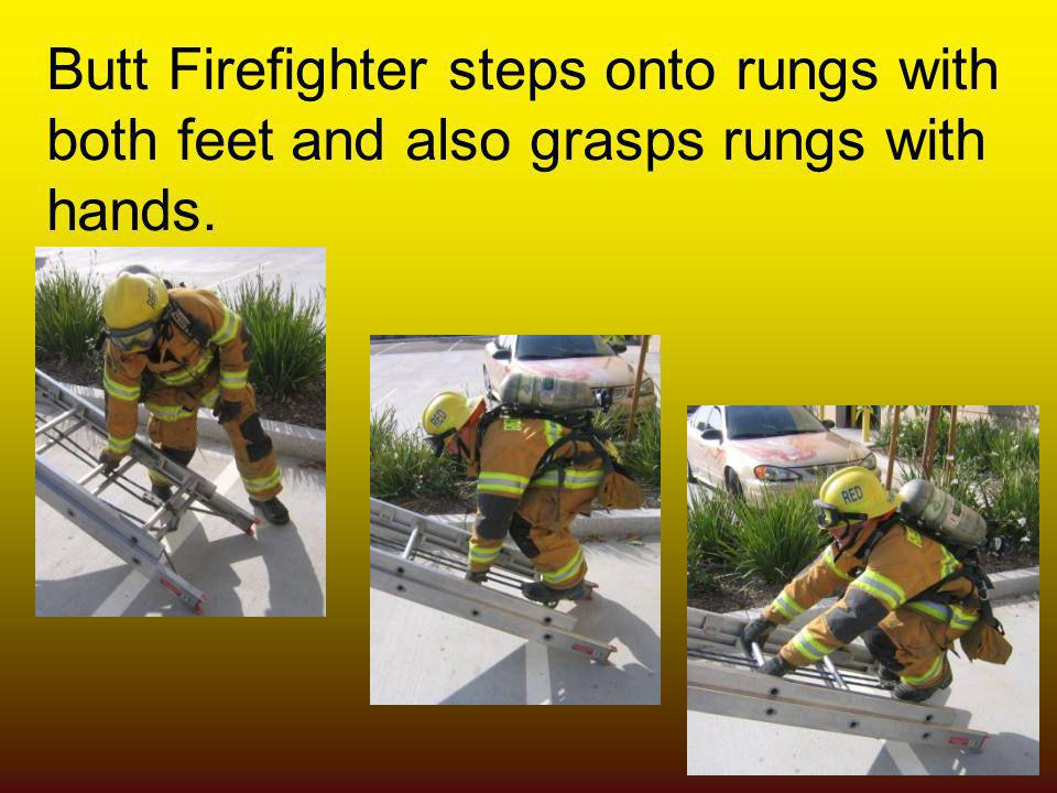 Butt Firefighter steps onto rungs with