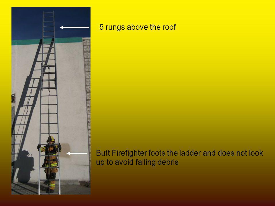 5 rungs above the roof Butt Firefighter foots the ladder and does not look.