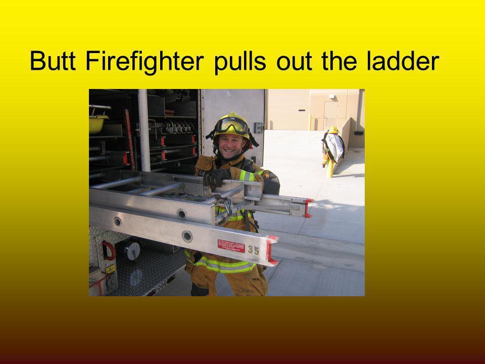 Butt Firefighter pulls out the ladder