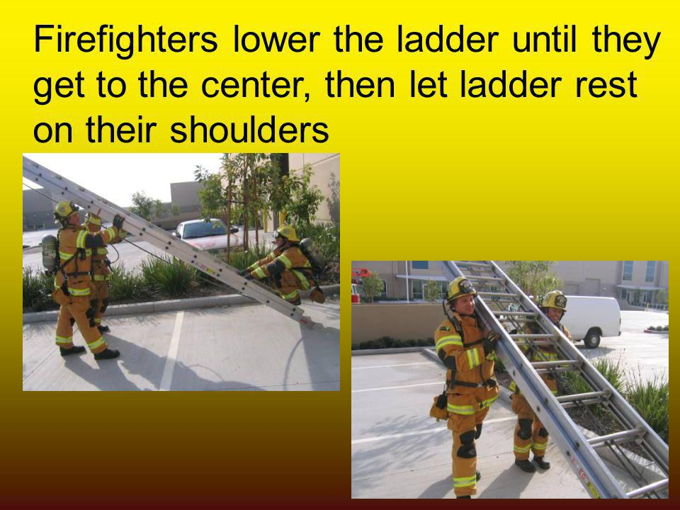Firefighters lower the ladder until they