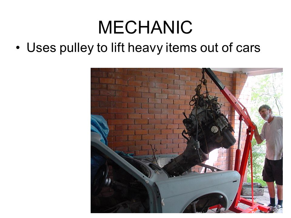 MECHANIC Uses pulley to lift heavy items out of cars