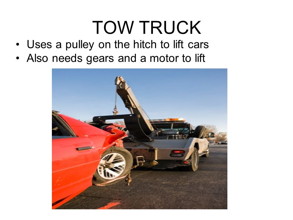TOW TRUCK Uses a pulley on the hitch to lift cars