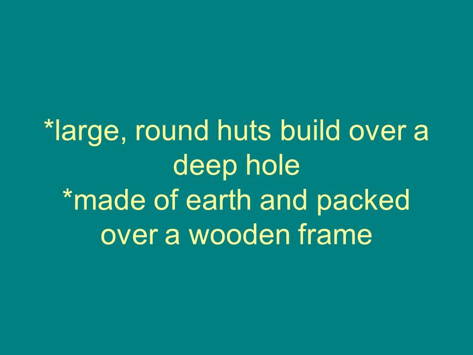 large, round huts build over a deep hole