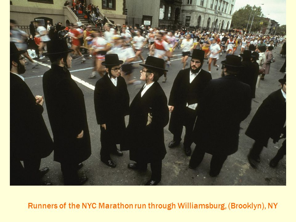 Runners of the NYC Marathon run through Williamsburg, (Brooklyn), NY